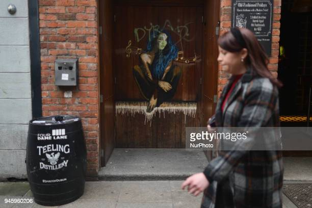 A lady passed by a graffiti in Dublin's city center On Friday April 13 in Dublin Ireland