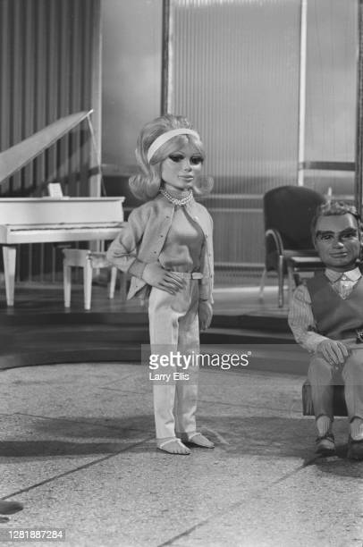 Lady Penelope Creighton-Ward, a marionette from the 'Thunderbirds' science fiction television series, UK, 1st September 1965. To the right is Jeff...