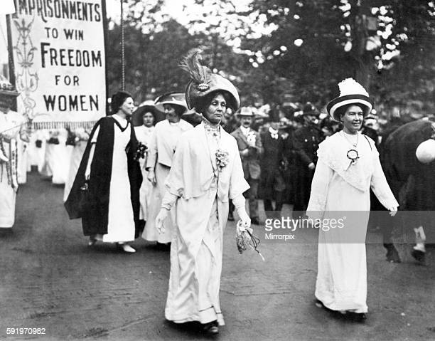 Lady Pethick-Lawrence and Mrs Pankhurst lead a Suffragette demonstration, Christabel Pankhurst follows behind her mother. Circa 1910.