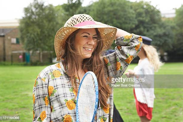 lady playing badminton in the park - racquet stock pictures, royalty-free photos & images