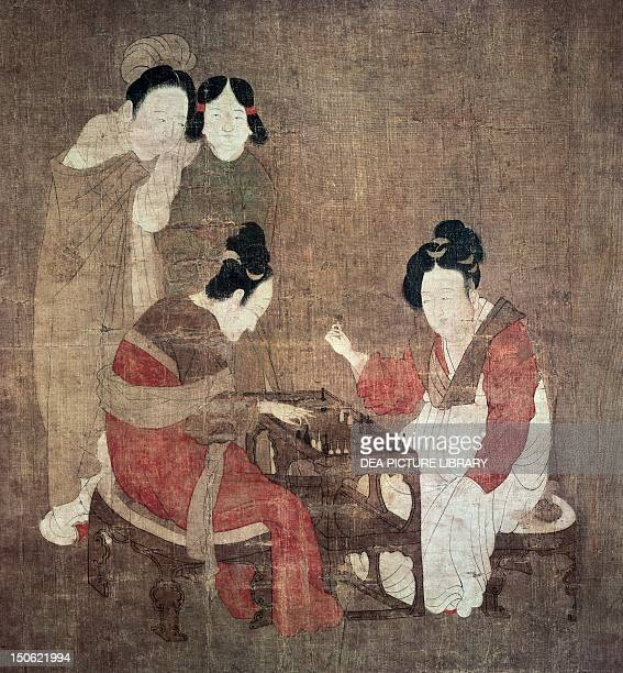 Lady playing double six copy of an original by Zhou Fang colour painting on a silk scroll China Detail Chinese Civilisation Southern Sung Dynasty...