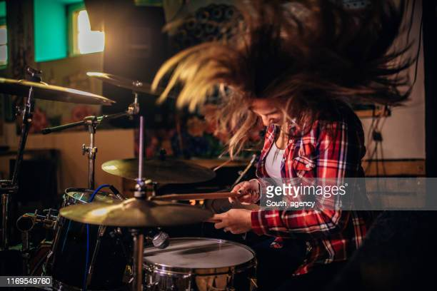 lady playing drums - drum kit stock pictures, royalty-free photos & images