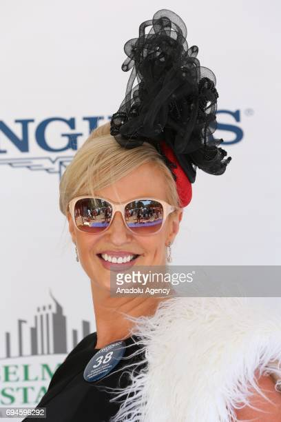 A lady poses for a photo during Longines Most Elegant Woman fashion contest on the 149th running of the Belmont Stakes at Belmont Park in Elmont...