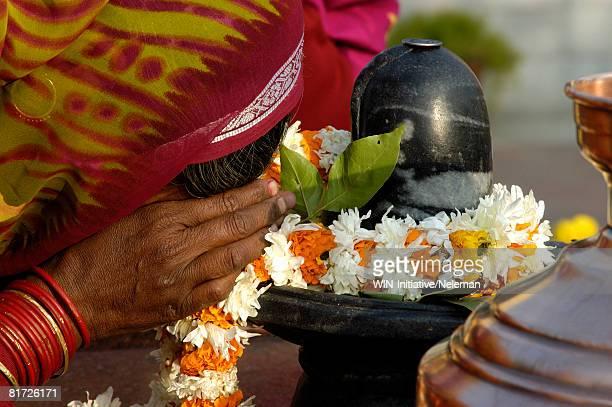 lady praying-shivling, close-up - shiva lingam stock pictures, royalty-free photos & images