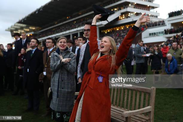 A lady racegoer adds vocal support during the last race on Ladies Day of the Cheltenham Festival at Cheltenham Racecourse on March 13 2019 in...