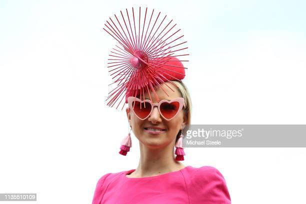 A lady racegoer in her finest dress during Ladies Day of the Cheltenham Festival at Cheltenham Racecourse on March 13 2019 in Cheltenham England