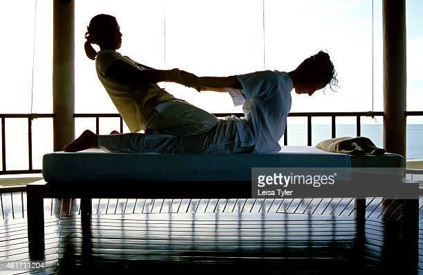 A lady receiving a Thai massage