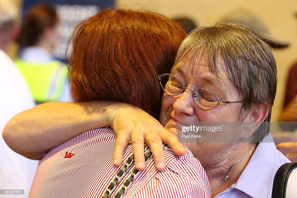 A lady recieves a hug during a community meeting to advise residents of the current fire situation at the Brown Park community centre on January 13, 2014 in Perth, Australia. Evacuated residents of Perth Hills are awaiting permission to access and inspect their properties after a bushfire blazed through the suburb, destroying 46 homes. Emergency services are assessing the affected area and expected the number of properties damaged to increase.