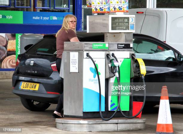 Lady refuels at a Harvest Energy petrol station selling unleaded petrol at 99.9p per litre, the first time since 2016 petrol has been sold below £1...