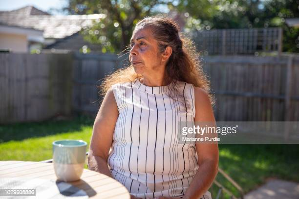 A lady relaxing in the sun with a cup of tea