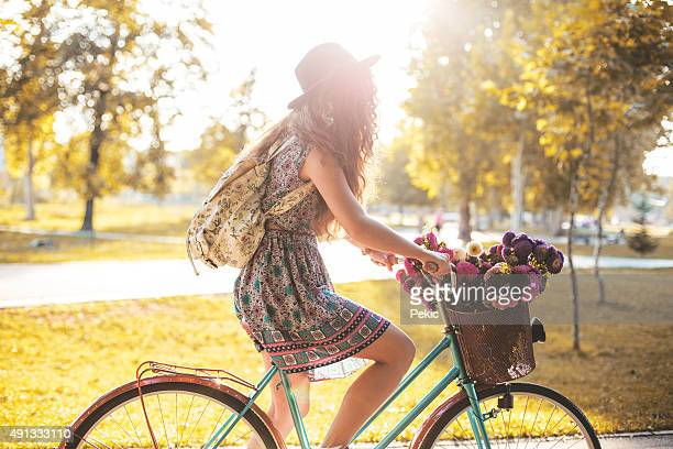 Lady riding her hipster retro bike in vintage style