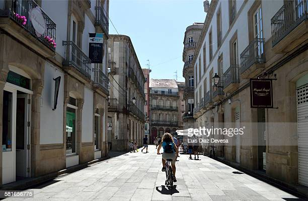 lady riding the bike - pontevedra province stock photos and pictures