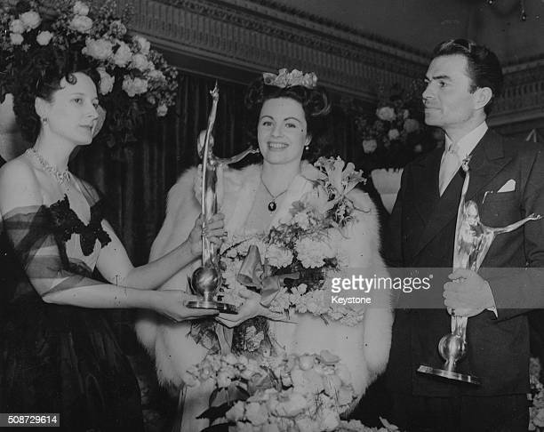 Lady Rothermere presenting acting awards to Margaret Lockwood and James Mason at the Daily Mail National Film Awards in the Dorchester Hotel London...