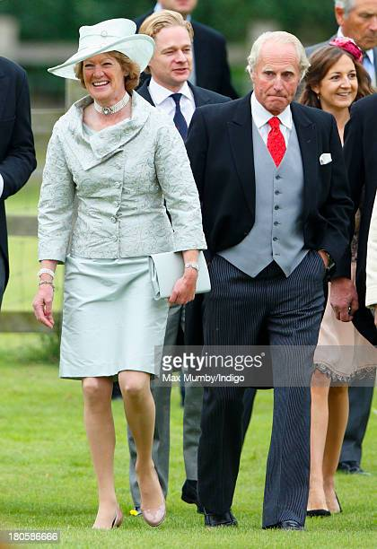 Lady Sarah McCorquodale and Neil McCorquodale attend the wedding of James Meade and Lady Laura Marsham at the Parish Church of St Nicholas in Gayton...