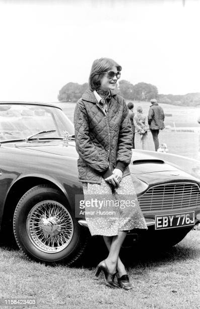 Lady Sarah Spencer a girlfriend of Prince Charles Prince of Wales and sister of Princess Diana stands beside Prince Charles's car at the Guards Polo...