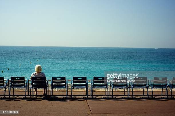 CONTENT] Lady seated and looking out to the Mediterranean on the Promenade des Anglais in Nice