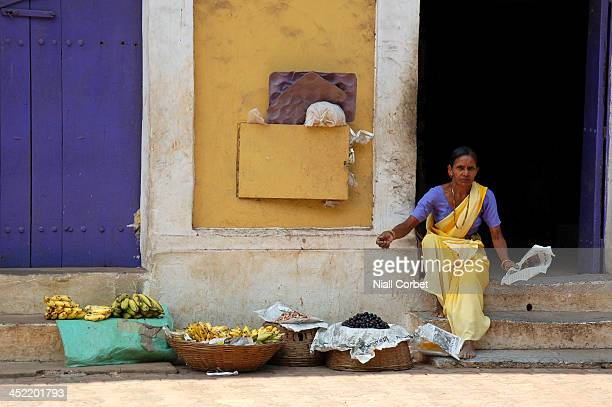 CONTENT] A lady selling fruit on the streets of Panjim Goa India