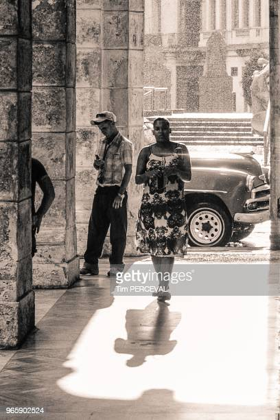 Lady shadow and car in the rain Hotel Sevilla Havana