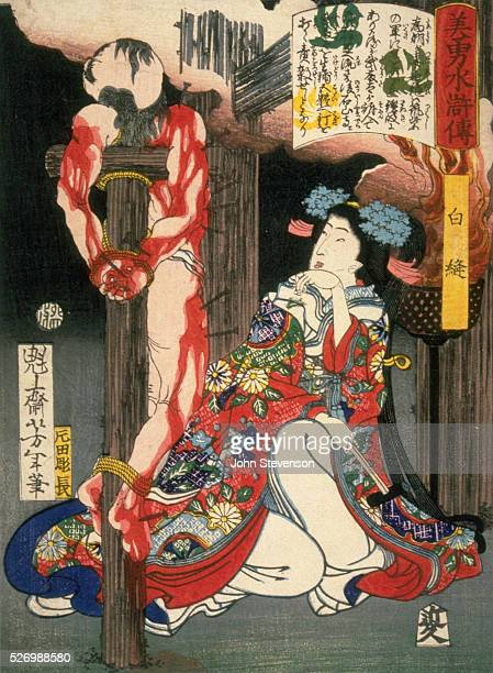 Lady Shiranui wife of Tametomo revenging herself on Mutota who exiled her husband Mutota crucified has been studded with nails Note the hammer still...
