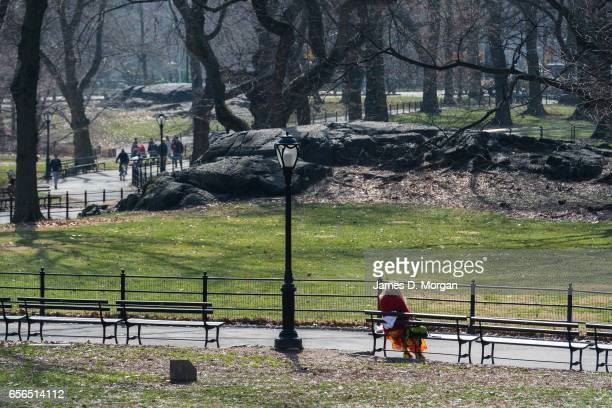 Lady Sitting and relaxing in Central Park in New York City on Feb 28th 2017
