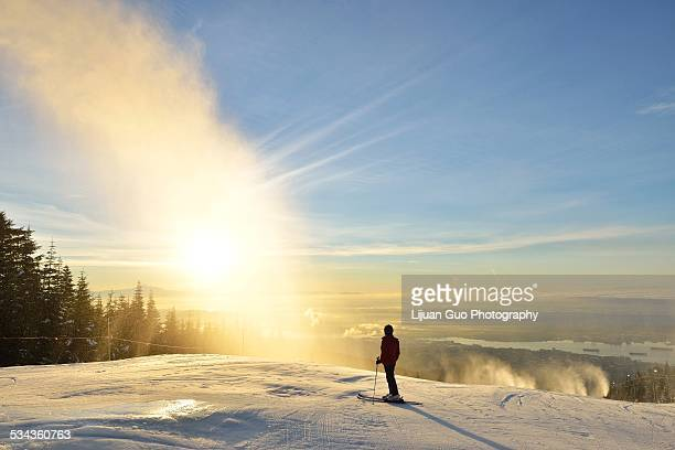 lady skier enjoy sunrise on grouse mountain - vancouver canada stock pictures, royalty-free photos & images