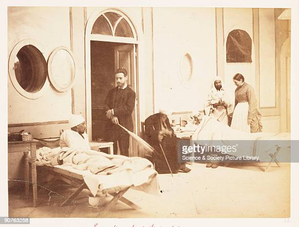 'Lady Strangford's Hospital in Arab's House Cairo Dr Liviking Egyptians wounded at TelelKebir' Photograph of wounded soldiers receiving treatment in...