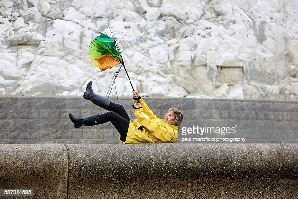 lady struggling with broken umbrella - inside out stock pictures, royalty-free photos & images
