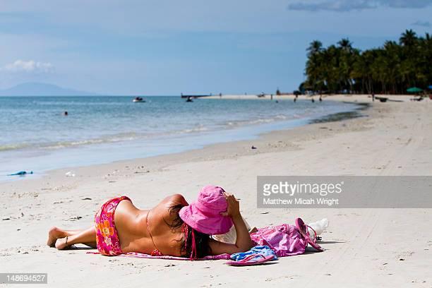 Lady sunbathing at Cenang beach.