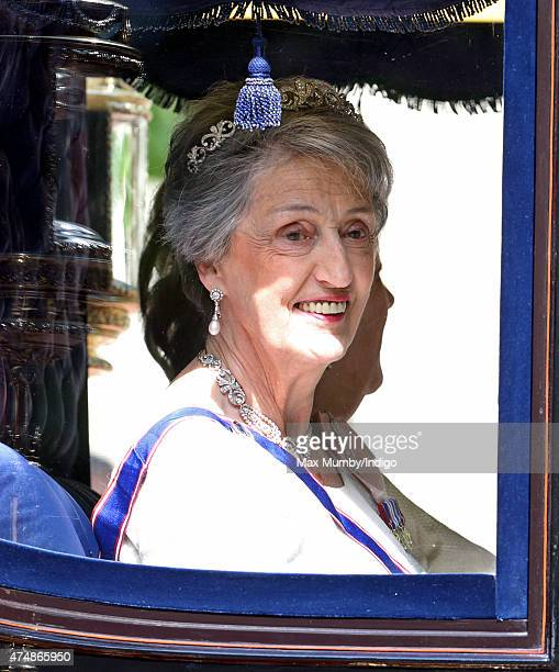 Lady Susan Hussey travels down The Mall in a horse drawn carriage to attend the State Opening of Parliament on May 27 2015 in London England