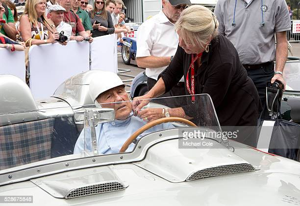 Lady Susie Moss helping Sir Stirling with his helmet strap in the1955 Mille Miglia winning Mercedes Benz 300 SLR