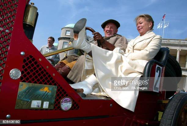 Lady Susie Moss with her husband Sir Stirling Moss dressed in period costume on a 1907 Renault at Goodwood House near Chichester West Sussex Thursday...