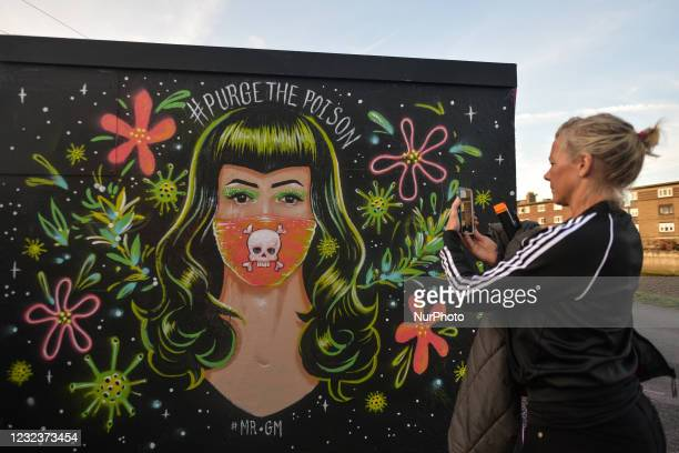 Lady takes a picture of a mural by Mr. Gabriel Marques seen in Dublin's Grand Canal area, during COVID-19 lockdown. . On Saturday, 17 April 2021, in...