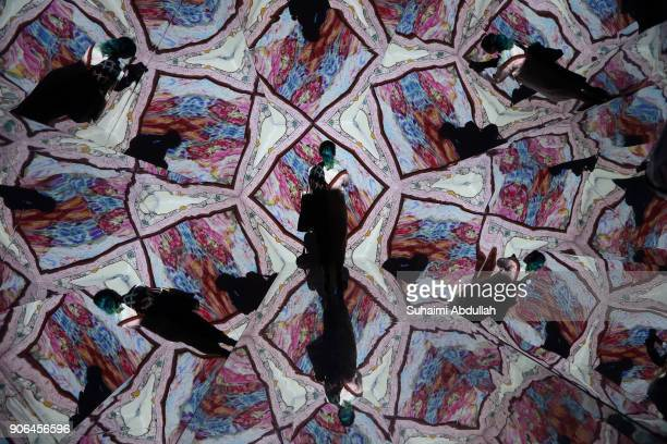 A lady takes photo inside a lifesized kaleidoscope installation titled ÔOH Treasure ChestÕ by Otherhalf Studio during the Light to Night Festival...