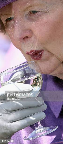 Lady Thatcher sips a drink at the Founders Day Parade at Chelsea Royal Hospital on June 5, 2008 in London, England. The Royal Hospital Chelsea, a...