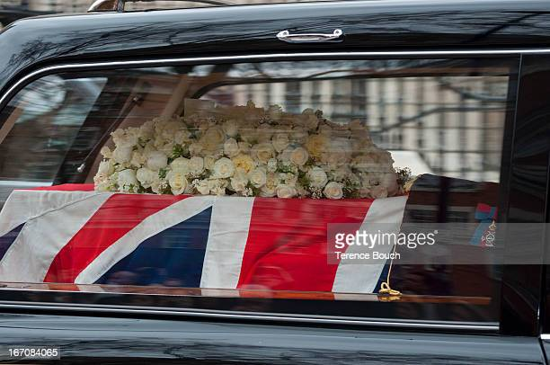 Lady Thatcher's flag draped coffin leaves St Paul's Cathedral by hearse for a private burial attended by only close family and friends after a...