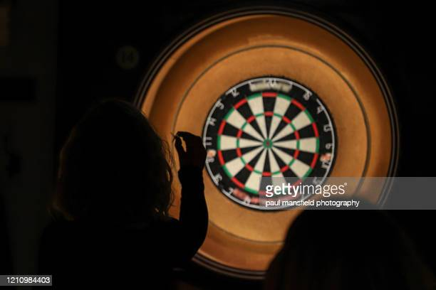 lady throwing darts - shooting at goal stock pictures, royalty-free photos & images