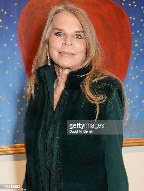 """Lady Tina Green attends a private view of """"And The Stars Shine Down"""" by Stasha Palos at the Saatchi Gallery on December 2, 2014 in London, England."""