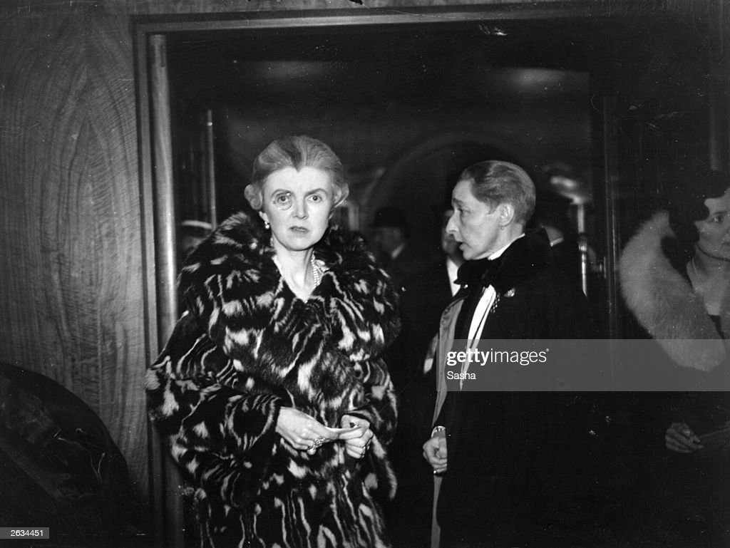 Lady Trowbridge and writer Radclyffe Hall (1886 - 1943) attending the first night of 'When Ladies Meet' at the Lyric Theatre in London.