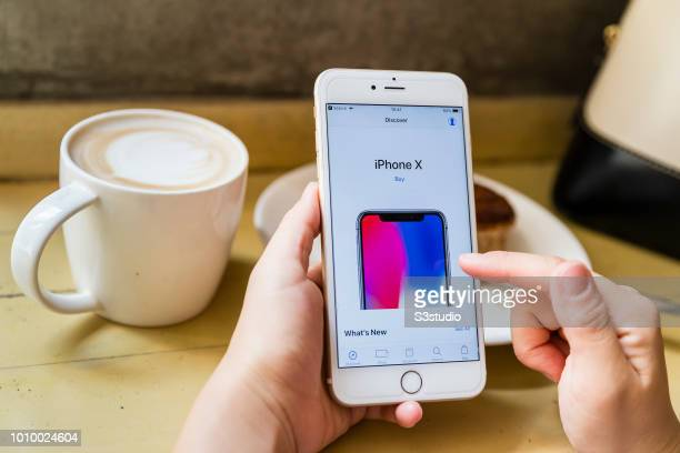 A lady using Apple Store app on iPhone in Hong Kong Hong Kong on July 30 2018 Apple has become the world's first public company to be worth $1...