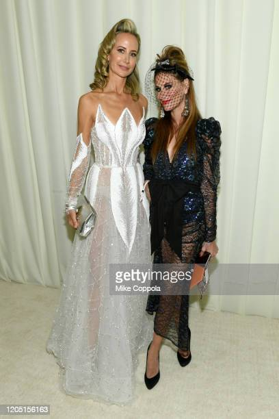 Lady Victory Harvey and Stacy Engman attend the 28th Annual Elton John AIDS Foundation Academy Awards Viewing Party sponsored by IMDb Neuro Drinks...
