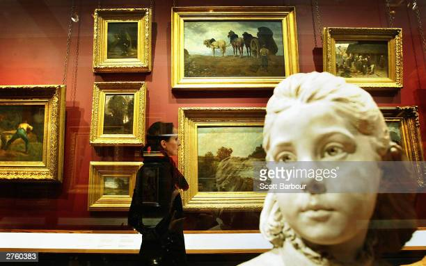 Lady views the work of artist John Constable at the Victoria & Albert Museum's new suite of galleries on November 25, 2003 in London, England. Works...