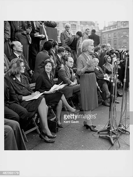 Lady Violet Bonham-Carter speaking at an anti-apartheid meeting in Trafalgar Square, sitting behind her are actress Vanessa Redgrave and Barbara...