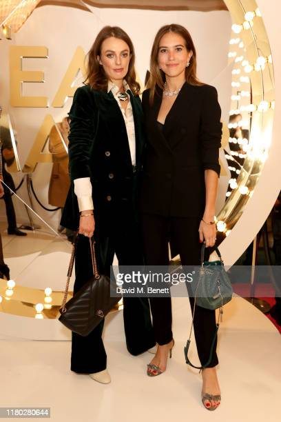 Lady Violet Manners and Natalie Salmon wearing Bvlgari attend the launch of the Bvlgari Cinemagia popup boutique at Harrods on October 10 2019 in...