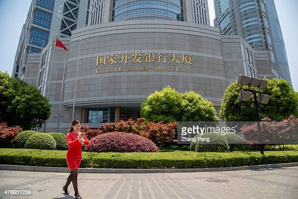 A lady walks in front of China Development Bank tower in Pudong On June 4 The South African logistics group Transnet announced it had obtained a loan...