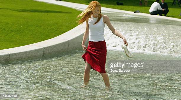 A lady walks in The Diana Princess of Wales Memorial Fountain in Hyde Park on June 29 2004 in London England The fountain by the American designer...