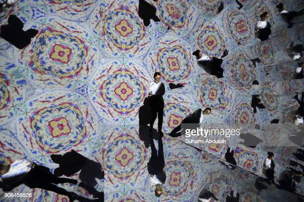 A lady walks inside a lifesized kaleidoscope installation titled ÔOH Treasure ChestÕ by Otherhalf Studio during the Light to Night Festival 2018...