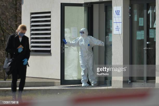 A lady walks out after being seen by a medical staff member of the University Hospital in Krakow one of 19 hospitals in Poland that are being...