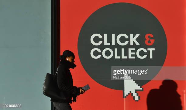 Lady walks past a click and collect sign Birmingham during the nationwide lockdown on January 05, 2021 in Birmingham, England. British Prime Minister...
