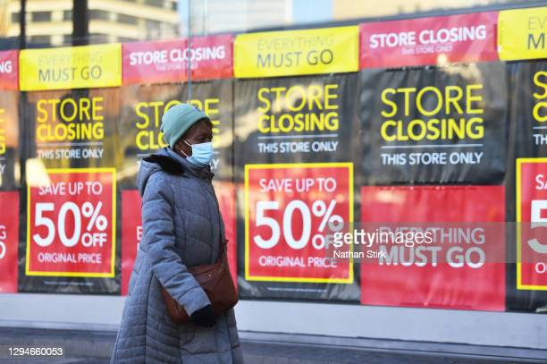 Lady walks past a closing down sign in Birmingham during the nationwide lockdown on January 05, 2021 in Birmingham, England. British Prime Minister...