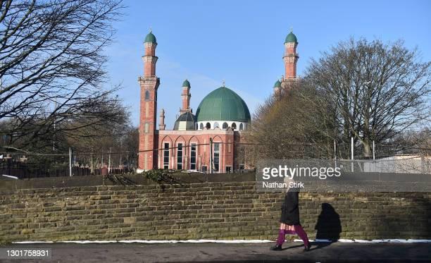 Lady walks past Al-Jamia Suffa-Tul-Islam Grand Mosque on February 12, 2021 in Bradford, England.